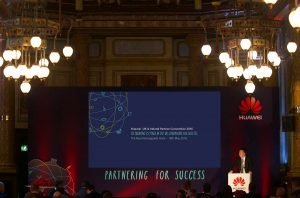 """The stage branded with the event's identity """"Partnering for success"""""""