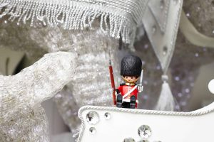 Photo of Hamleys Queen's guard toy sitting on white sleigh