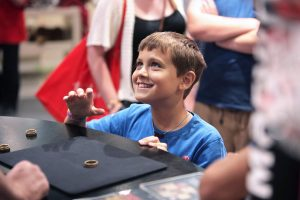 Boy smiling in Hamleys store