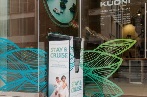 Store front dispenser branded in Kuoni's Stay&Cruise campaign's identity