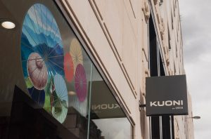 Kuoni's store front with signage and window graphic from Far East Pioneers campaign