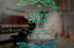 Detail of store window design featuring type lockup from Stay&Cruise campaign