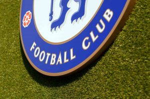 Chelsea crest installation on astroturf at Stamford Bridge, bottom detail